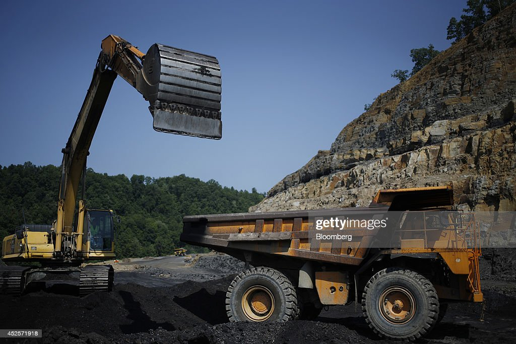 An excavator loads the contents of a salvaged coal seam unearthed during the construction of a new segment of U.S. Highway 460, part of the Appalachian Development Highway System, into a dump truck near the Virginia border in Elkhorn City, Kentucky, U.S. on Tuesday, July 22, 2014. Senate Democrats may bring to the floor a House-passed measure that would replenish federal funds for highway and mass-transit projects through May 2015. As part of that debate, senators could vote on two Democratic alternatives, although leaders say the House measure is more likely to prevail. Photographer: Luke Sharrett/Bloomberg via Getty Images