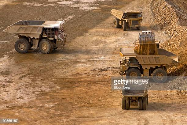 An excavator moves earth into mining trucks at the AngloGold Ashanti Ltd Cripple Creek Victor gold mine in Victor/Cripple Creek Colorado US on...