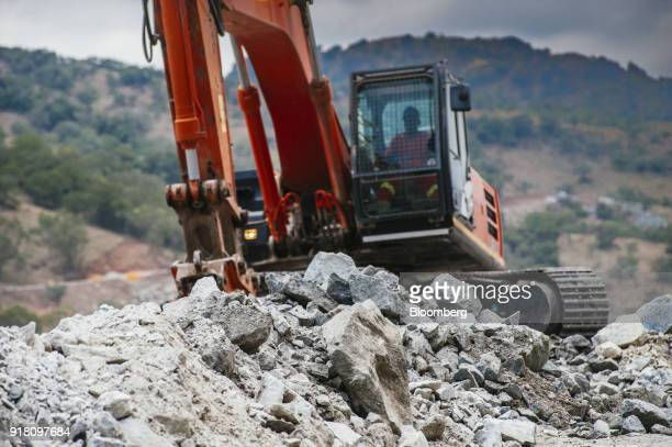An excavator moves raw aluminum ore at the Northam Platinum Ltd Booysendal platinum mine outside the town of Lydenburg in Mpumalanga South Africa on...