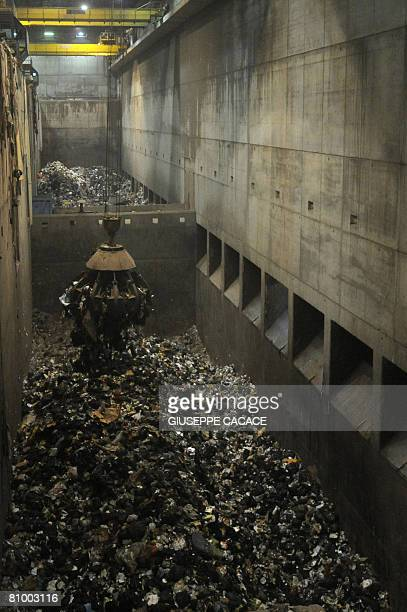 An excavator moves rubbish inside the Silla incinerator in Milan on May 6 2008 The European Commission sued Italy before an EU court for failing to...