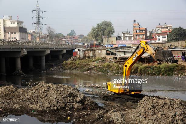 An excavator operates along the Bagmati River in Kathmandu Nepal on Wednesday Nov 1 2017 India and China have often jostled for influence in Nepal a...