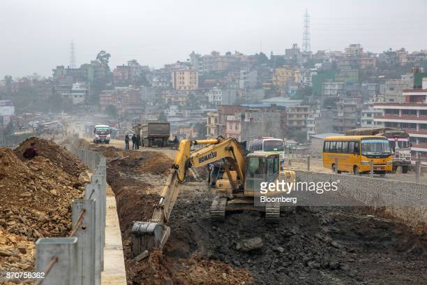 An excavator operates at a construction site for a road in the Kalanki Chowk area of Kathmandu Nepal on Wednesday Nov 1 2017 India and China have...