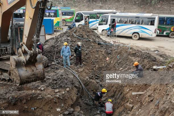 An excavator operates at a construction site for a road operated by Shanghai Construction Group Co in the Kalanki Chowk area of Kathmandu Nepal on...