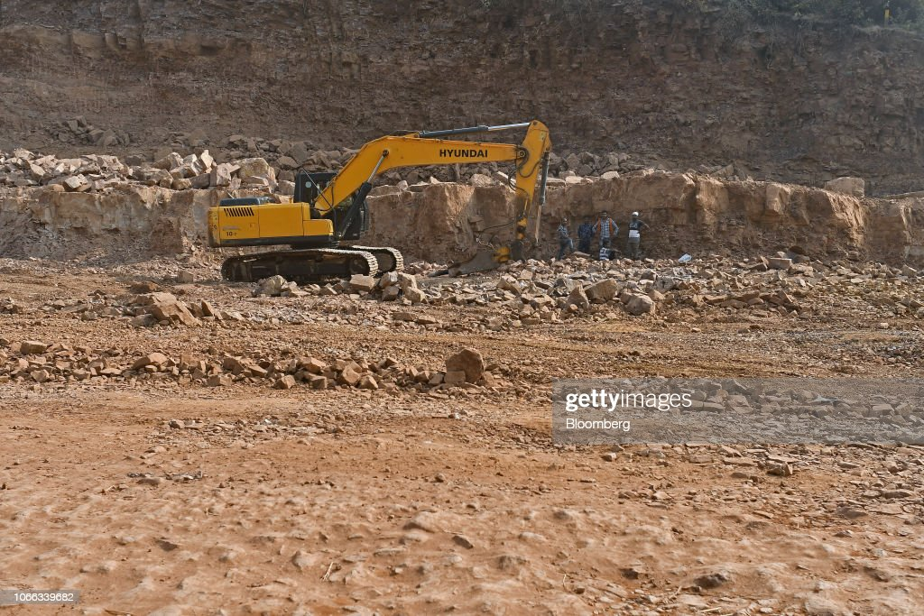 An excavator operates at a road construction site in Bhopal