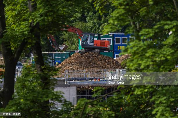 An excavator operates on a residential apartment block construction site, on a plot of brownfield land in the Vysoany district in Prague, Czech...