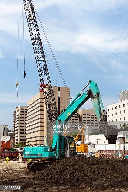 An excavator operates on the construction site of the first stage of the Osaka Station North District project known as 'Kita Yard' in Osaka Japan on...