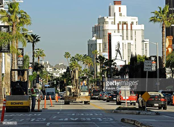 "An excavator slows dowen the traffic in the construction zone of Sunset Boulevard, also known as ""The Sunset Strip,"" where work has began on the $7..."