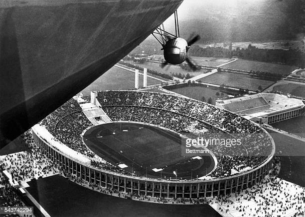 An excellent aerial view of the Olympic stadium, made from the giant German dirigible Hindenburg, nearly 100,000 persons were in the stadium when the...