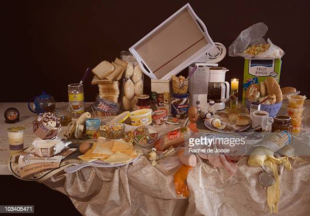 An excess of breakfast foods on a table, still life