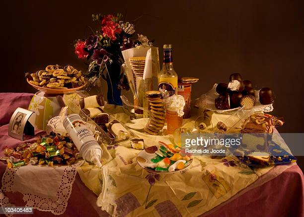 An excess of candy and sweets on a table, still life