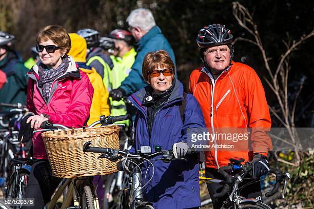 An excited maturer couple wait amongst a large group of cyclists for the official opening of the Devonshire Tunnel as part of the Bath Two Tunnels...