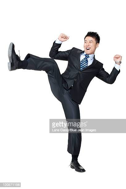 an excited young businessman - legs apart stock pictures, royalty-free photos & images