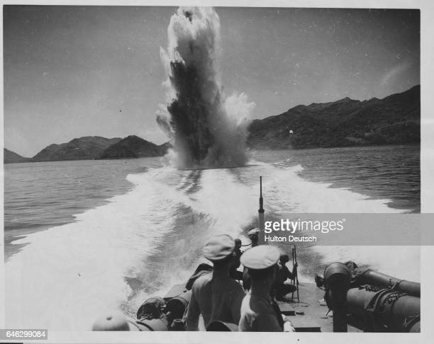 An exclamation point made of TNT is dropped from a Navy fast motor torpedo boat ready to puntuate any Axis submarine line that may be prowling in the...