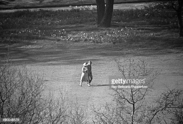 An exclusive photograph of Queen Elizabeth II walking with her uncle The Duke of Windsor in gardens of Buckingham Palace London on 30th March 1965...