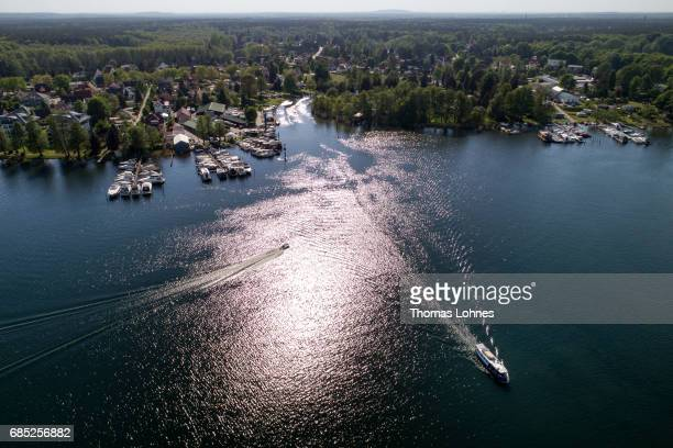 An excursion boat drives across the lake 'Werlesee' in Brandenburg state on May 19 2017 in Fangschleuse near Erkner Germany Brandenburg with its...