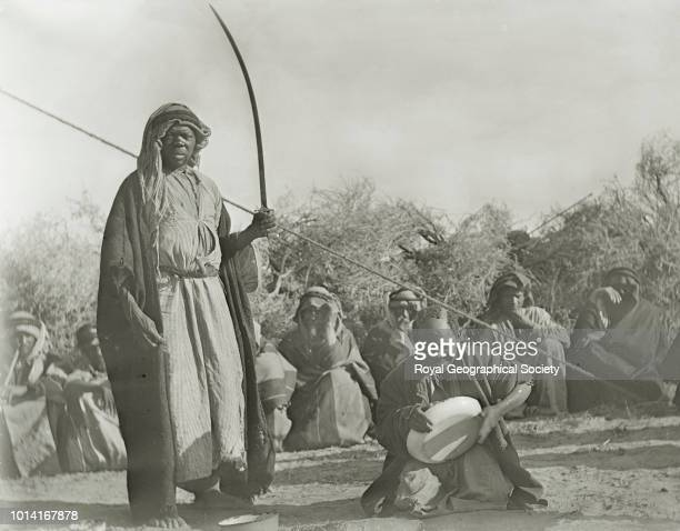 An execution of Abu Dhahir This image shows a man with sword in his hand about to behead another man Saudi Arabia 04 March 1911