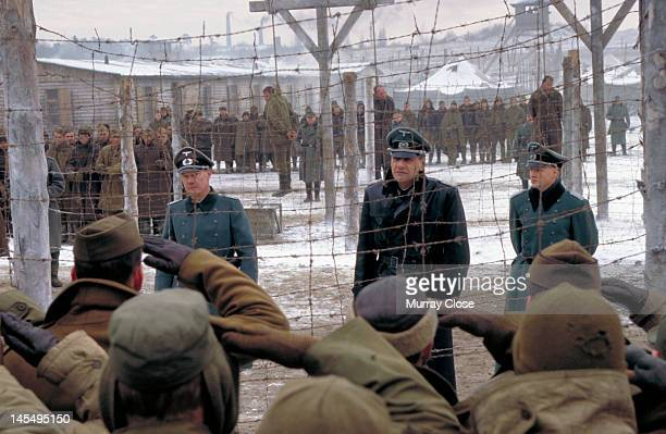 An execution scene in a German prisonerofwar camp from the film 'Hart's War' 2002 Actor Bruce Willis leads his men in a salute watched by David...