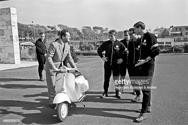 An executive of Piaggio delivering a Vespa as a gift to the players of Italian football club Inter Appaiano Gentile 1963