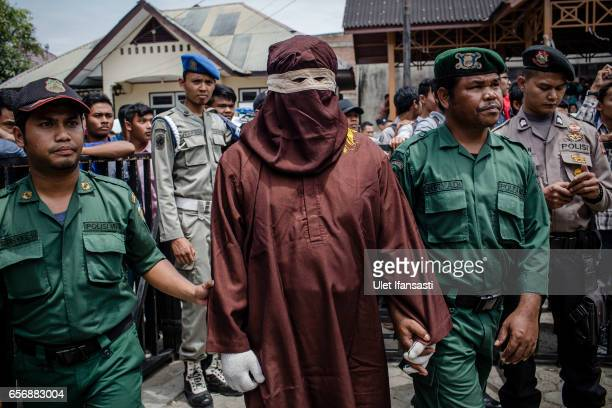 An executor known as 'algojo' stands as prepare public caning for violations against Sharia law on March 20 2017 in Banda Aceh Indonesia Indonesia's...