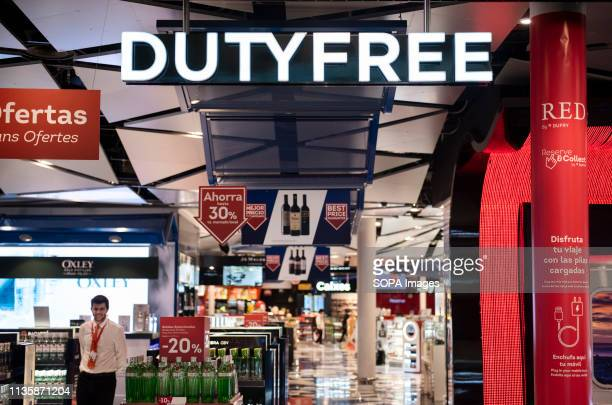 An exempt of national taxes and duties store, duty-free, logo and shop is seen at Barcelona's El Prat Josep Tarradellas airport.