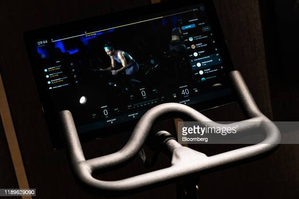 An exercise class is displayed on the screen of a Peloton Interactive Inc. Stationary bicycle at the company's showroom on Madison Avenue in New...