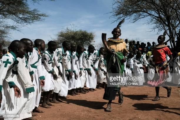 TOPSHOT An exfemale genital mutilation cutter of the Pokot tribe Chepureto Lobul reacts during a meeting with journalists in Katabok village...