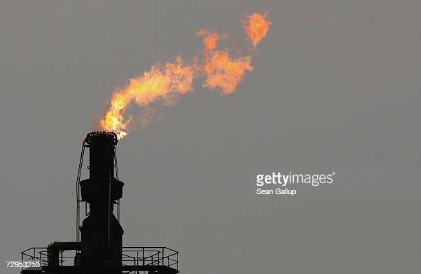 An exhaust flame burns at the PCK crude oil refinery January 9 2007 near the Polish border in Schwedt Germany Crude oil from Russia has stopped...