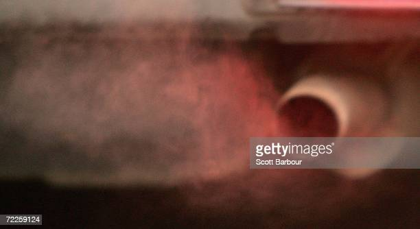 An exhaust pipe of a 4x4 vehicle releases fumes on October 25 2006 in London England Gasguzzling vehicles are being targeted by local authorities to...