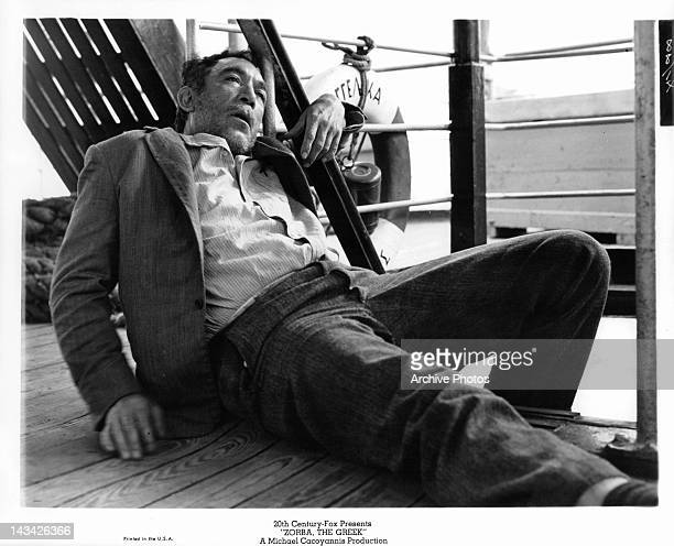 An exhausted Anthony Quinn in a scene from the film 'Zorba The Greek' 1964
