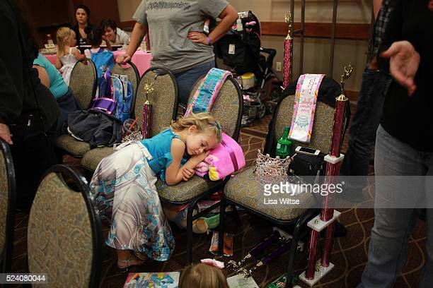 An exhausted contestant taking a rest during the three hour crowning at the Angel Face Nationals in the Holiday Inn LIverpool New York October 28...