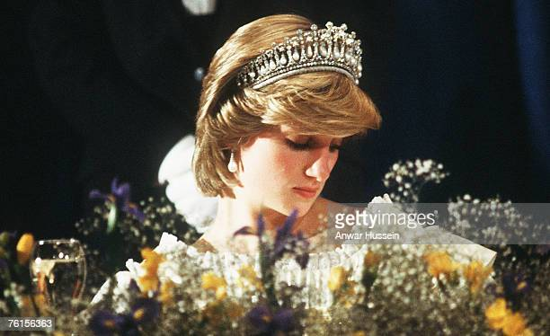 An exhausted Diana Princess of Wales looks as though she's fallen asleep during a banquet in June 1983 in Canada