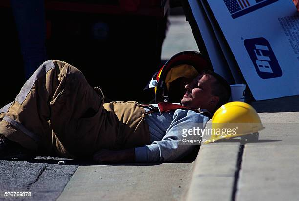 An exhausted fireman rests after searching through wreckage after the bombing of the Alfred P Murrah Federal Building