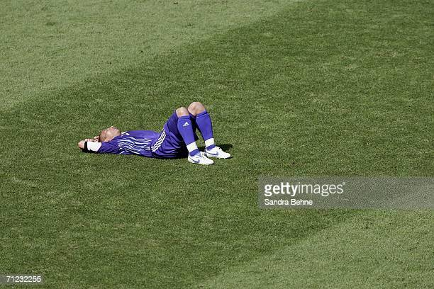 An exhausted Hidetoshi Nakata of Japan lies on the pitch following his team's 00 draw during the FIFA World Cup Germany 2006 Group F match between...