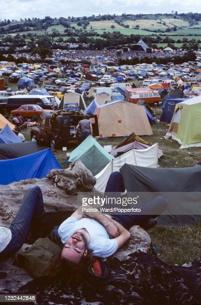 An exhausted music fan at the Glastonbury Pop Festival in Somerset, circa June 1985.