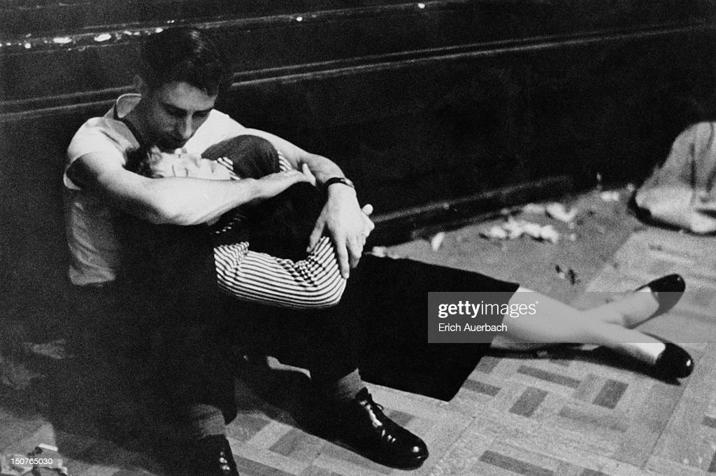 An exhausted young couple during an all-night jazz session at the Royal Albert Hall in London, circa 1957.