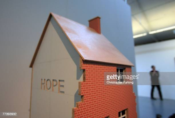 An exhibit by Turner Prize nominated artist Nathan Coley is viewed by visitors at Tate Liverpool on 18 October 2007 in Liverpool England The Turner...