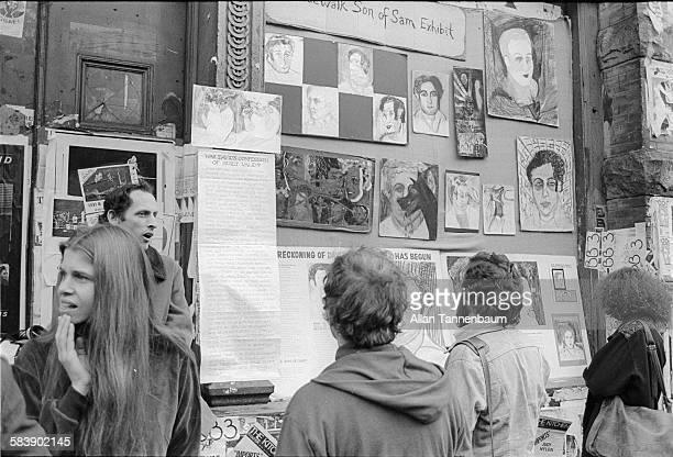 An exhibit of art works related to the 'Son of Sam' on the sidewalk of West Broadway in SoHo New York New York November 14 1978