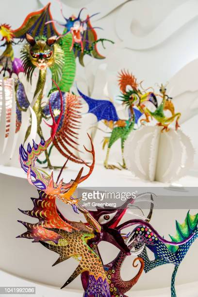An exhibit of fantasy mythical creatures sculptures inside the Popular Art Museum in Mexico