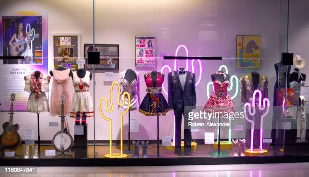 An exhibit of stage costumes and musical instruments worn and played by country music singer Kacey Musgraves at the Country Music Hall of Fame and...
