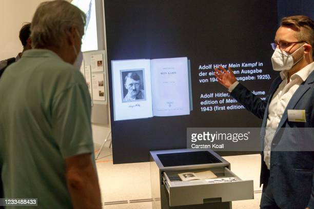 An exhibit shows the book Mein Kampf of Adolf Hitler in the new Documentation Center for Displacement, Expulsion and Reconciliation on June 16, 2021...