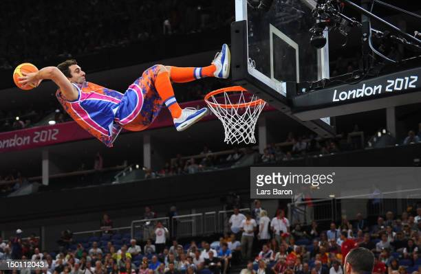 An exhibition dunker performs during a break in the Men's Basketball semifinal match between Russia and Spain on Day 14 of the London 2012 Olympic...