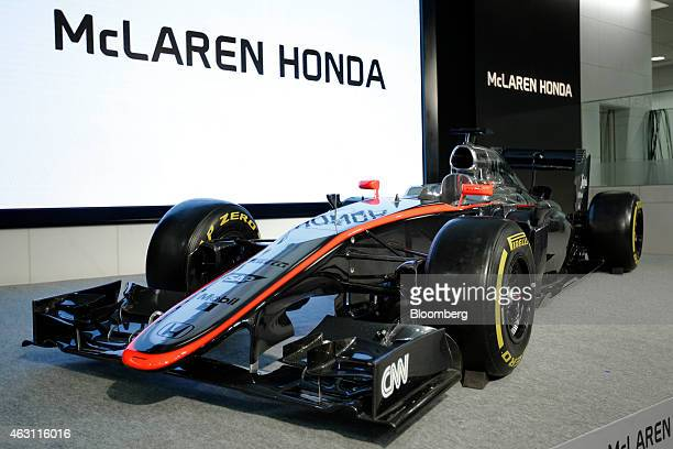 An exhibition model of a McLaren-Honda MP4-30 Formula One racecar, produced by McLaren Group Ltd., stands on display during a news conference in...