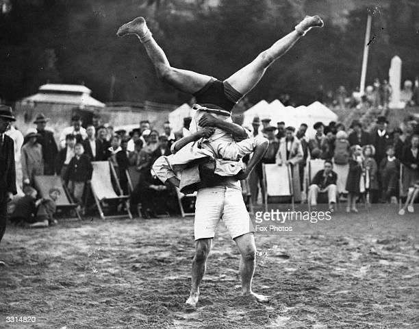 An exhibition of Cornish wrestling on the beach at Looe, Cornwall.
