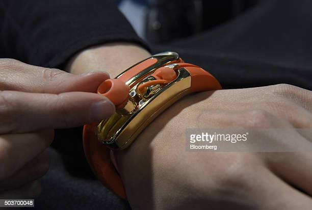 An exhibitor demonstrates the Ashley Chloe Helix Cuff Smart Wireless Headphones during the 2016 Consumer Electronics Show in Las Vegas Nevada US on...