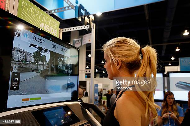 An exhibitor demonstrates the iFit Everywhere Inside treadmill at the 2014 Consumer Electronics Show in Las Vegas Nevada US on Wednesday Jan 8 2014...