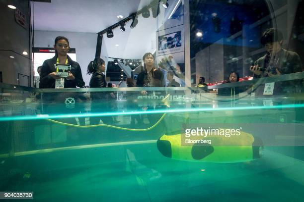 An exhibitor demonstrates the Shenzhen Qysea Technology Co Fifish P3 underwater robot during the 2018 Consumer Electronics Show in Las Vegas Nevada...