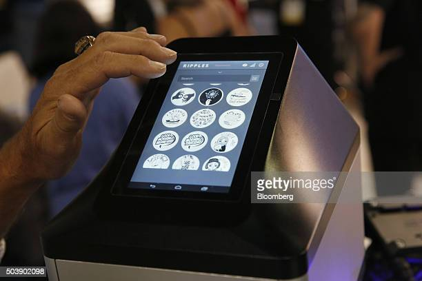 An exhibitor demonstrates the Steam CC Ripple Maker during the 2016 Consumer Electronics Show in Las Vegas Nevada US on Thursday Jan 7 2016 CES is...