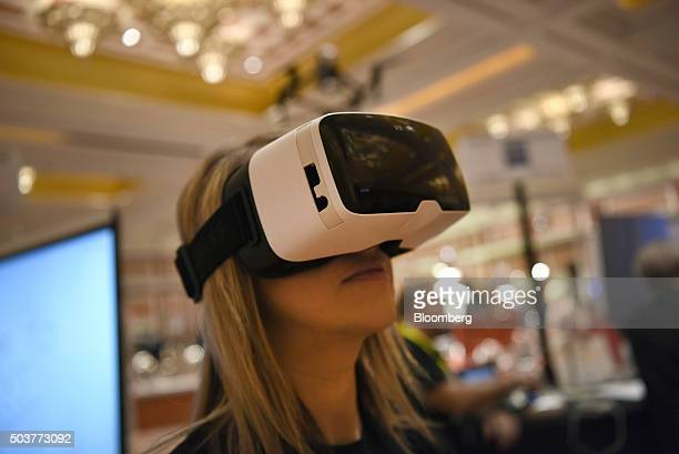 An exhibitor demonstrates the ZEISS VR ONE headset during ShowStoppers at the 2016 Consumer Electronics Show in Las Vegas Nevada US on Wednesday Jan...