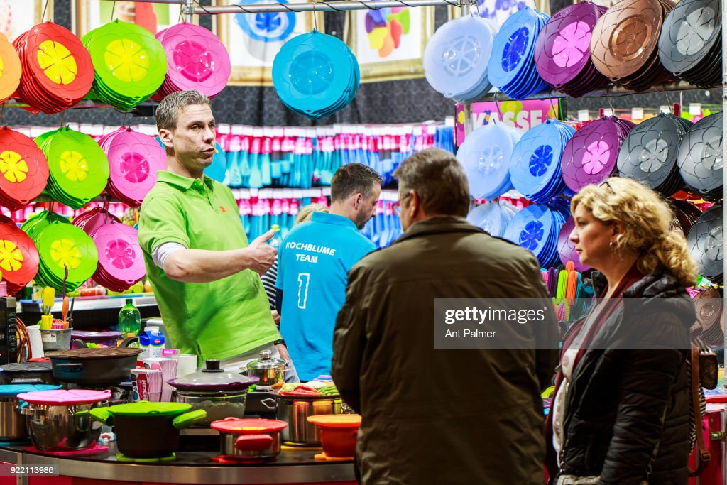 An exhibitor demonstrates their cooking appliance at the start of the Reise + Camping exhibition on February 21, 2018 in Essen, Germany. The annual event features over 1000 exhibitors from over 20 countries.