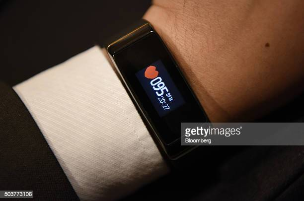 An exhibitor displays a 3Plus Activity Tracker for a photograph during ShowStoppers at the 2016 Consumer Electronics Show in Las Vegas Nevada US on...